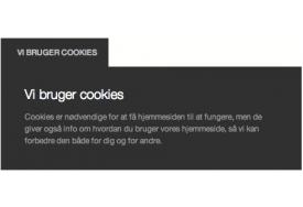 CookieNote modulet til Magento viser her cookie-info i mørkt farvetema